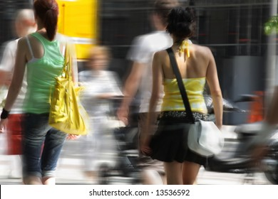 shopping. two young women with bag in the city