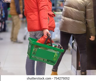 Shopping wallpaper customer with basket full of goods in store