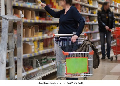 Shopping wallpaper story of aged female customer with cart select goods on shelves in store