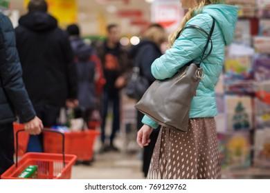 Shopping wallpaper story of female customer wait near shelves in store