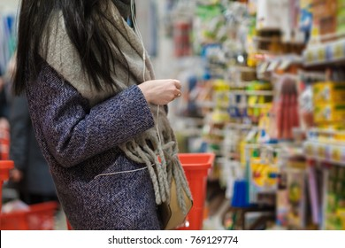 Shopping wallpaper story of female customer with basket select goods on shelves in store. Stationery department