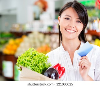 Shopping woman with a credit card looking happy
