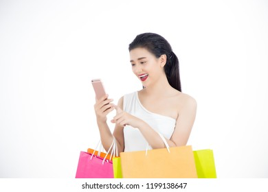Shopping woman happy smiling holding shopping bags on white background.