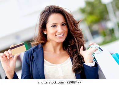 Shopping woman holding a credit or debit card