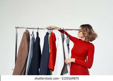 shopping woman in red dress picks out clothes
