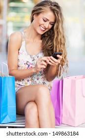 Shopping woman text messaging