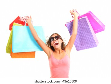 Shopping woman very excited. Shopping. Dynamic picture of young woman on a shopping spree with lots of bags.