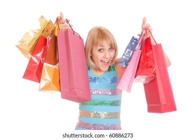 Shopping women smiling. Isolated over white background