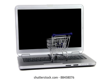 shoppingcart in front of black laptop screen