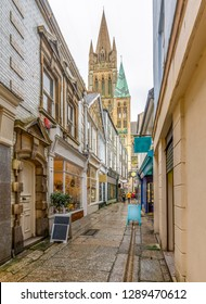 Shops in Cathedral Lane, Truro in Cornwall, with views of the Cathedral spires