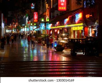 Shops and restaurants at night along Zeng Yang Bu Xing Jie in Guilin, Guangxi, People's Republic of China - October 9, 2011