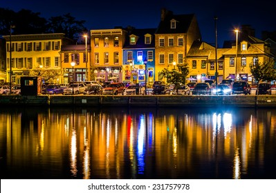 Shops and restaurants at night in Fells Point, Baltimore, Maryland.