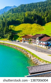 Shore of beautiful Achensee lake with houses on sunny summer day with blue sky, Karwendel mountain range, Tyrol, Austria