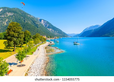 Shore of beautiful Achensee lake on sunny summer day with blue sky, Karwendel mountain range, Tyrol, Austria