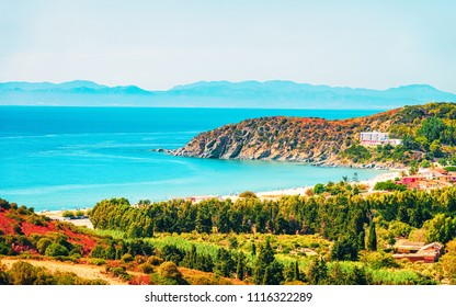 Shore of Beautiful Villasimius Beach at the Bay of the Blue Waters of the Mediterranean Sea on Sardinia Island in Italy in summer. Cagliari region.