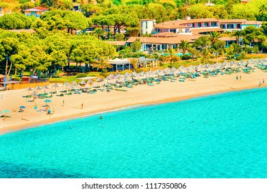 Shore of Beautiful Villasimius Beach at the Bay of the Blue Waters of the Mediterranean Sea at Sardinia Island in Italy in summer. Cagliari region.