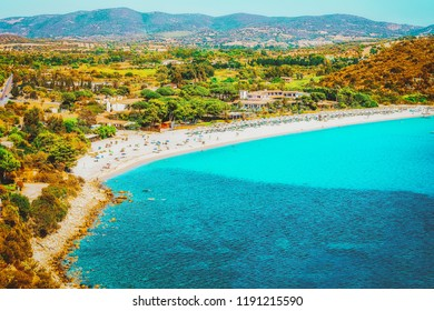 Shore of Beautiful Villasimius Beach at the Bay of the Blue Waters in the Mediterranean Sea in Sardinia Island in Italy in summer. Cagliari region.