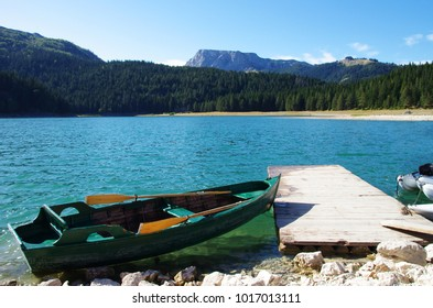 The shore of the Black Lake and a boat (Durmitor Park, Montenegro)