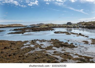 Shore with boatyard Island of Barra, Scotland