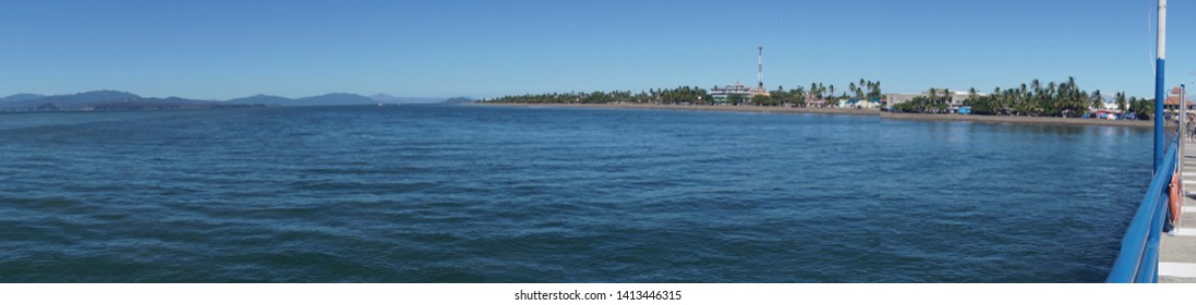 Shore and distant hills from the beach resort port of Puntarenas, Costa Rica
