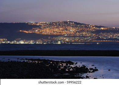 The shore of Lake Kinneret and the city of Tiberias at night