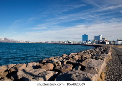 The shore line of Faxa Bay in the city of Reykjavik Iceland