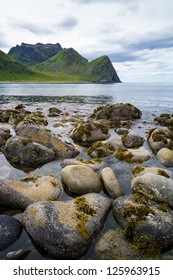 Shore and mountains in Unstad, Lofoten Norway