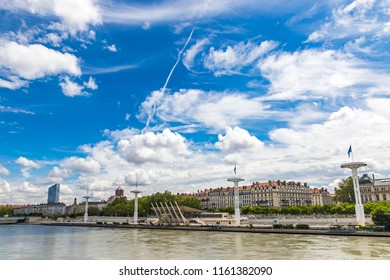 Shore of the Rhone river in center of Lyon city, Auvergne-Rhone-Alpes region, France. Centre nautique on the background