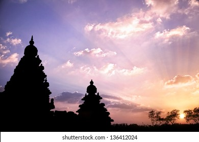 Shore temple silhouette at sunset sky in Mamallapuram, Tamil Nadu, India