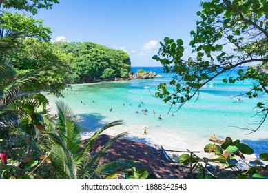 Shore of Winnifred Beach, Jamaica. Turquoise waters, little wave