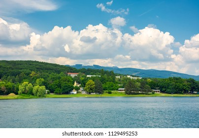 shore of Zemplinska Sirava, Slovakia in summer. beautiful and calm scenery of one of the largest Slovakian body of water. Vihorlat Mountains in the distance