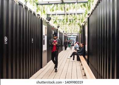 Shoreditch, London, England, UK - April 2019: Hipster People enjoying the indoor space top floor at BOXPARK  Shoreditch East London