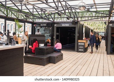 Shoreditch, London, England, UK - April 2019: People eating and drinking inside the indoor space top floor at BOXPARK  Shoreditch East London