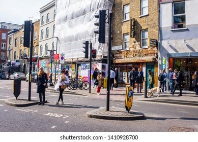 Shoreditch, London, England, UK - April 2019: People walking and crossing the road  on Redchurch Street near Brick lane, Shoreditch East London