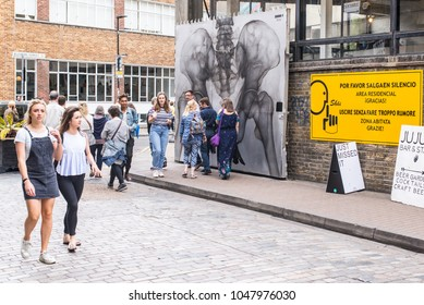 Shoreditch, London, UK - June 2017: People enjoying the warm summer at The Old Truman Brewery, Ely's Yard, Shoreditch, London, UK