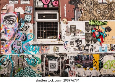 Shoreditch, London, UK - June 28 2015: Wall covered in graffiti and wallpaper murals in the trendy area near Brick lane, Shoreditch, East London.