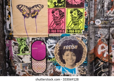 Shoreditch, London, UK - October 25 2015: Wall covered in graffiti and wallpaper murals in the trendy area of Brick lane, Shoreditch, East London.
