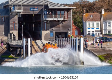 Shoreham, UK. 15th September 2019. RNLI lifeboat launches from the slip way to attend a memorial service with the HM Coastguard at Worthing. Credit SEUK News/Alamy Live News.