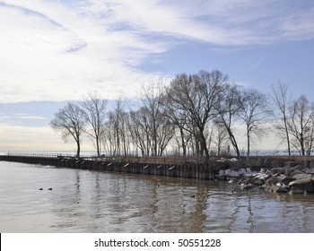 shoreline along the Bronte Beach park Oakville Ontario, Winter bare tree lake landscape