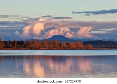 The shoreline of a lake frames Spencer Butte in the background of this scenic taken in the southern Willamette Valley of Oregon.