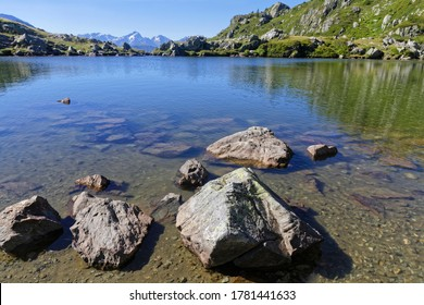 Shoreline of the mountain lake in Pas de la Coche