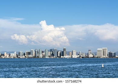 A shoreline, panoramic view of downtown San Diego, California shot from the harbor.
