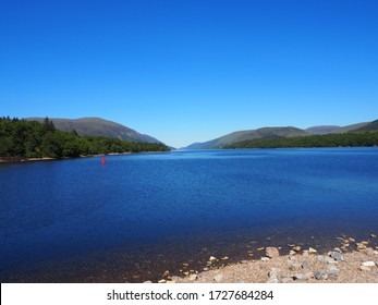 From the shores of Loch Lochy in Lochaber, the Scottish Highlands on a sunny cloudless summers day. Part of the Great Glen and the Caledonian Canal.