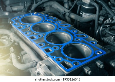 Short block with installed cylinder head gasket. Repair of a turbocharged diesel engine in a car workshop. Close up. Blur effect.