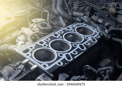 Short block with installed cylinder head gasket. Repair of a turbocharged diesel engine in a car workshop. Blur effect.
