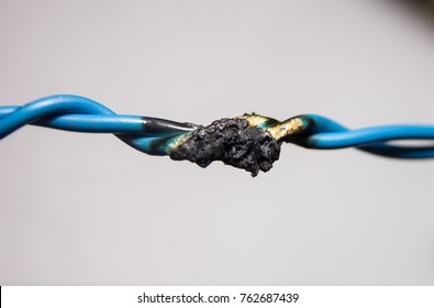 Short circuit, the burned cable, on a light background