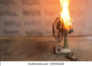 Short circuit faults burnt Old electric fan./Electricity short circuit .