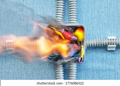 Short circuit in home electric wiring cause fire. Violation of safety rules led to ignition of wire insulation. Damage wires are danger to house. Accident burning in a household power grid.