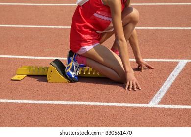 short distance runner ready to start, closeup of photo
