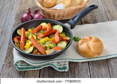 Short fried vegetables with spicy Debreziner sausages served in a frying pan